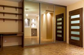 bedroom track lighting ideas. sleek wardrobe design with mirrored sliding doors for modern bedroom ideas using adorable track lighting e
