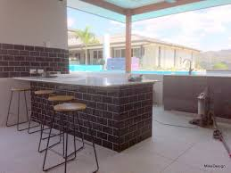 outdoor bbq kitchen island benchtop with tiled support wall