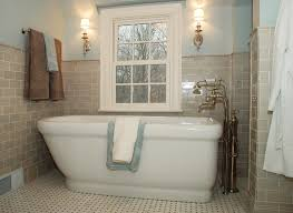 traditional bathroom lighting ideas white free standin. Cream Subway Tile Bathroom And Freestanding Bathtub Under Small Window Two Wall Sconces Traditional Lighting Ideas White Free Standin T