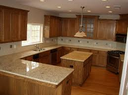 oak cabinets with granite countertops as painting countertops