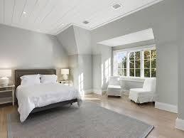 dark gray bed with mirror nightstands