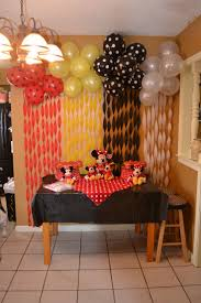 backdrop....balloons with same color streamers