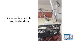 garage door makes a sound but won t open
