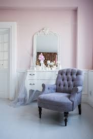 classical armchair and mirror table at living room interior stock photo images