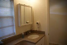 white wooden bathroom furniture. Bathroom. Square White Wooden Bathroom Cabinet With Mirror Door Over Vanity Brown Furniture I