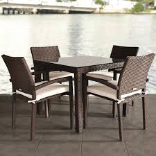 atlantic liberty 4 person resin wicker patio dining set with glass top table and stacking chairs ultimate patio