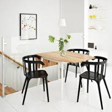 dining room whitesburg dinitte table with black dining chair also flower vase and green plant besides