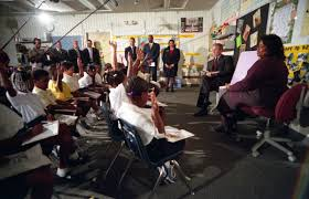 new photos show moment president bush learned of attacks  president george w bush participates in a reading demonstration on the morning of tuesday 11 2001 at emma e booker elementary school in
