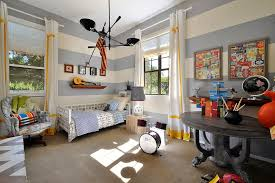 Grayish blue and cream walls provide a very nice background for bright  yellow accents in this