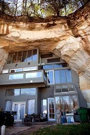 would totally have a vacation home built like this if the cave overlooked  the ocean Amazing house built into a sandstone mine in the side of a  mountain in ...