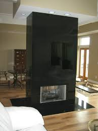 it utilizes solid pieces of polished majestic black from floor to ceiling with a hearth width of 18
