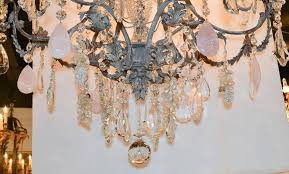 superb custom made ernesto klun patinated iron twelve light crystal chandelier having beautiful