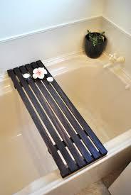 dark wood bathtub caddy with interior potted plant and cozy bathtub for small bathroom design