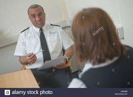 w being interviewed by policemen interviewee played by model stock photo w being interviewed by policemen interviewee played by model