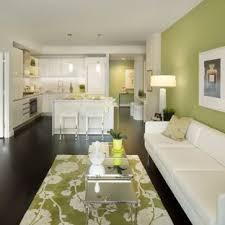 exle of a trendy open concept dark wood floor and black floor living room design in