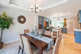 light blue kitchen cabinets dining room traditional with beige dining chair beige image by luxe interior international