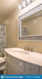 Extended Bathroom Vanity Light Vertical Toilet And Vanity Unit Inside A Bathroom With