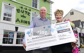 Lottery winners David and Penny Bradley at their pub in Aberdare, Wales, UK  | Athena Pictures