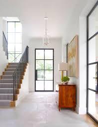 Contemporary entryway design with window paneled front door ...