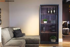 an industrial wooden bookcase in a living room
