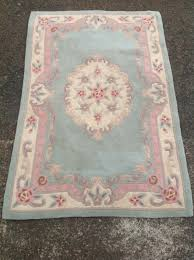 lot 561 a rectangular chinese style thick pile wool rug woven in pastel fl