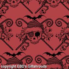our extreme gothic pirate santa stripey candy canes bat spider black holly and skulls this has it all gothic pirate santa red giftwrap