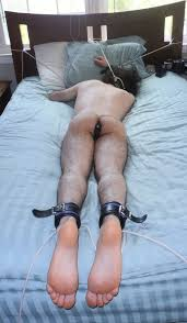Male in bondage butt plugged