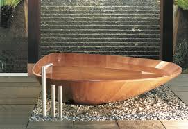 while not a traditionally deep soaking tub the ocean shell wooden bathtub by bagno sasso