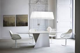 go old fashion with a twist when choosing your dining table with a cream colored marble round table with a base that is wooden art itself