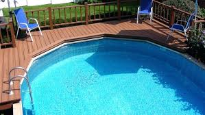 cost to maintain a pool above ground swimming pool enclosed in a deck with chairs and