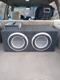 The sub setup in my daily. 2 first gen Rockford P2 10 inch woofers hooked  up to a Boston GTA 802.: CarAV
