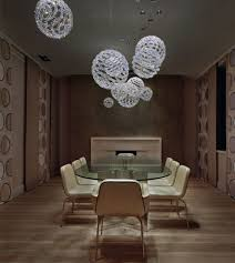 marvelous design ideas using round glass chandeliers and oval glass tables