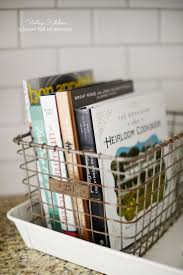 dishy kitchen counter decorating ideas: i love how the cookbooks look sitting in a pretty wire basket on the counter