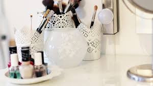 in the left corner i have my make up brushes holders also from ikea and a