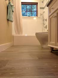 tile flooring next to hardwood photos