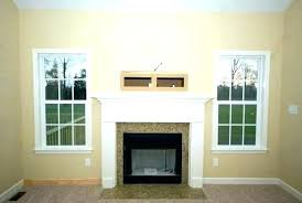 above fireplace post cabinet over design hide tv wires
