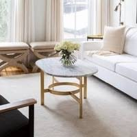 Round or oval coffee tables are good for gathering groups & easy to maneuver around. West Elm White Marble Brass Oval Coffee Table Aptdeco