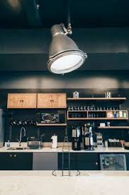 overhead industrial kitchen lighting in one of our wework nyc office spaces overhead office lighting