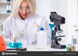 Lab Analyst Woman Lab Analyst Working On New Drugs Stock Photo