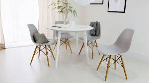 4 seater white and grey eames round dining set