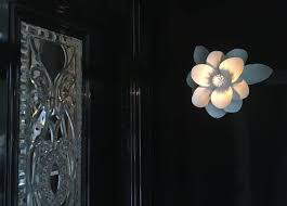 here is the magnolia sconce illuminated at the front door of the home doesn t this make a statement at the entry of this southern home