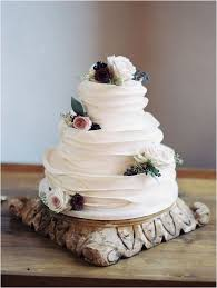 Picture Of A Beautiful White Ruffle Wedding Cake With Blooms And