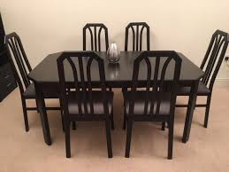 high quality scandinavian black wooden extendable dining room table and 6 chairs