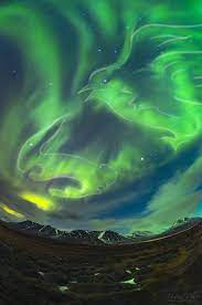 Bright Green Aurora Bird Takes Flight with a Running Rabbit Over Iceland  (Photo) | Space
