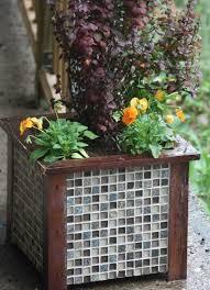 gorgeous tiled wooden planter for garden decor
