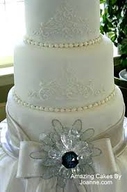stylish silver wedding cake designs Silver Wedding Anniversary Emcee Script white and silver wedding cake Wedding Reception Program