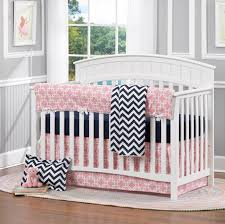 navy and pink baby bedding
