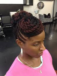 here we have this natural hair twisted updo with a twisted swept bang the first thing that jumped out to me is the hits of red burgundy