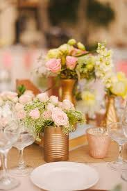 easy centerpiece idea- spray paint cans gold and fill with pretty flowers