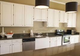 rectangle brown wooden islands white kitchen cabinets with dark granite countertops brown laminated wooden floor design